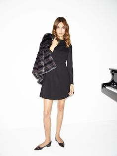Alexa Chung pairs her black, long-sleeve dress with a faux fur jacket for a very real touch of vintage-style glamor. Alexa Chung for Tommy Hilfiger. Daily Alexa Chung, Alexa Chung Style, Tommy Hilfiger, Feminine Style, Her Style, Celebrity Style, Street Style, Style Inspiration, Stylish