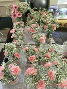 Baby's breath and carnations= cheap! No burlap and lace though