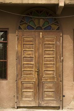 Old wooden door with stained glass transom in Kuwait.  Looks very similar to one of our custom designs!  travel. doors of the world.  Kuwait.  Middle East.