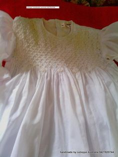 smocked gown with pearl and hand embroidery 0427820744 cutiepye australia...only 5 workers pls order way ahead of event