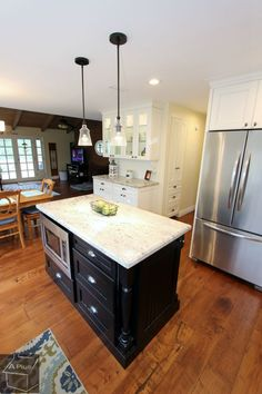 Transitional style Kitchen Remodel with Custom white cabinets in the city of Orange California
