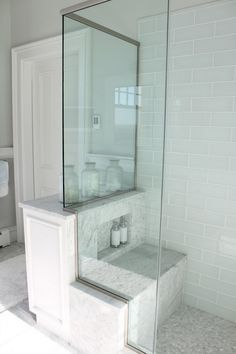 bathrooms - pale blue gray glass shower tile brick pattern carrara marble seat penny tile floor walls molding white vintage cannisters  Pretty