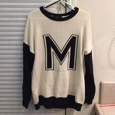 'M' sweater Black and Cream/Off-White  'M' sweater from Forever 21. Worn once. Unable to trade or models as I'm selling for my sister.   ✅ SHIPS SAME/NEXT DAY ✅ ADDIT PICS/MEASUREMENTS ✅ BUNDLE DISCOUNTS ❌ PAYPAL ❌ TRADES Ⓜ️ CHEAPER ON MERC Forever 21 Sweaters Crew & Scoop Necks
