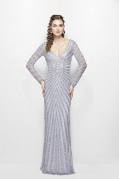 d4fb782343 Primavera Evening 1963 Make a fashion statement in this stunning long  sleeve dress with spectacular beading that radiates from waist as focal  point.