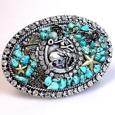 western belt buckle with turquoise, rhinestones & bucking horse accent. A great fashion piece for all cowgirls. Coming soon to  Ropes & Rhinestones. http://www.ropesandrhinestones.com