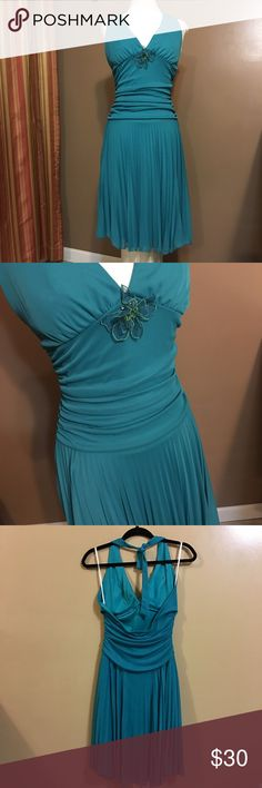 Teal Party Dress Cute & Fun Teal Party Dress! Size: Medium. Halter top w/ flower detail on front w/open back. Fun & flowy! *Pre-Loved & in great shape! Ruby Rox Dresses