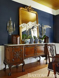 Navy Dining Room - This Dining Room Server Is GORGEOUS! An antique server in the dining room matches the classic look of the table and chairs. A large mirror above reflects the ceiling's gold tint. Love the two silverware chests on the buffet too! Dining Room Server, Dining Room Blue, Dining Tables, Mirrors In Dining Room, Dining Room Wallpaper, Dining Buffet, Dining Decor, Side Tables, Console Table