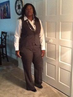 Plaid women's pant suit with crisp white shirt.