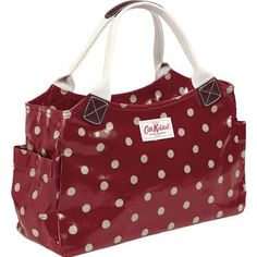This practical design in our classic Spot print is a popular choice of bag for everyday essentials. The durable oilcloth finish makes it easy to wipe clean and it is completed with cotton webbing handles and leather trim. Other handy features include a main zip fastening and internal zipped pocket, so you can be sure your belongings are kept safe. And just to finish it off - there are two handy side pockets - great for housing your brollie or a bottle of water!