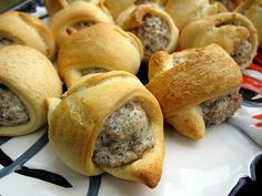 Sausage & Cream Cheese Crescents- Brown Jimmy Dean sausage, drain, rinse add Philly Cream Cheese. Lay out Pillsbury Crescent roll triangles, scoop 1 spoon of meat mixture into triangle of dough and fold. Bake according to roll directions until brown. Delicious!