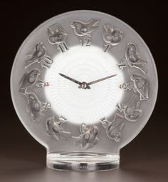 R. LALIQUE CLEAR AND FROSTED GLASS ROSSIGNOLS CLOCK Circa 1931. Stenciled R. LALIQUE, FRANCE