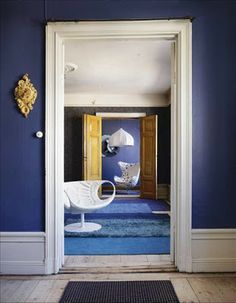 Blue Interior Design With Walls And Rugs
