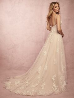 Miley-Rebecca Ingram Wedding Dress Delicate floral lace motifs cascade over layers of tulle in this simple yet romantic A-line wedding dress. Beaded spaghetti straps complete the V-neckline and open back. Finished with crystal buttons over zipper closure. Western Wedding Dresses, Lace Wedding Dress, Wedding Dresses Photos, Perfect Wedding Dress, Designer Wedding Dresses, Dream Wedding Dresses, Bridal Dresses, Wedding Gowns, Event Dresses