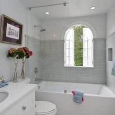 nice small bathroom with tub and shower in one