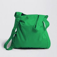 Green Cotton Notabag transforms itself easily from a shopping bag into a backpack. When not in use, it folds down into the attached pouch.