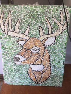 Glass mosaic of a deer. Made by me for my sweet husband!!