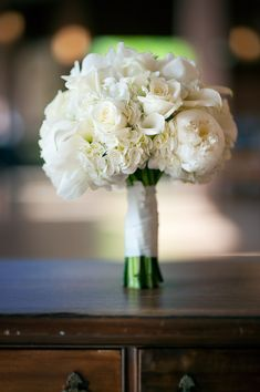 white bouquet with peonies, roses, lilies, and hydrangeas.