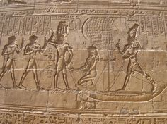 Edfu. Relief in the Court of Offerings depicting the annual Festival of the Beautiful Meeting, during which Hathor's image sailed from Dendera to spend some intimate time with Horus in the sanctuary of the Temple of Edfu before sailing back. The faces were later destroyed by iconoclasts