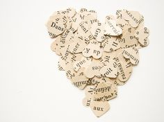 50 French Punched Hearts - Confetti or Papercraft - vintage paper, wedding decoration, romantic. $2.25, via Etsy.