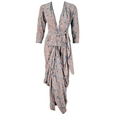 1930's Lucien Lelong Haute-Couture Novelty Surrealism Print-Silk Draped Dress | From a collection of rare vintage suits, outfits and ensembles at http://www.1stdibs.com/fashion/clothing/suits-outfits-ensembles/