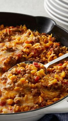 Need a quick-fix dinner that's ready to eat in 30 minutes? Look no further than this five-ingredient skillet dinner that has all of the great flavors of nachos. Shredded cheese, Spanish rice, ground b (Mexican Recipes With Ground Beef) Healthy Beef Recipes, Ground Beef Recipes For Dinner, Dinner With Ground Beef, Mexican Food Recipes, Dinner Recipes, Recipes With Spanish Rice, Ground Beef Recipes Simple, Spanish Rice Recipe With Ground Beef, Health And Wellness