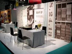 beautiful larger linen table skirts in front of the dauphine booth, bridal show booth ideas