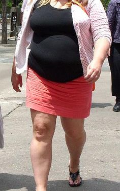 Love the way she wrinkles her skirts! She likes short and tight, perfect fit with her shape to crush intense wrinkles all down the front. She has a matching green skirt too...