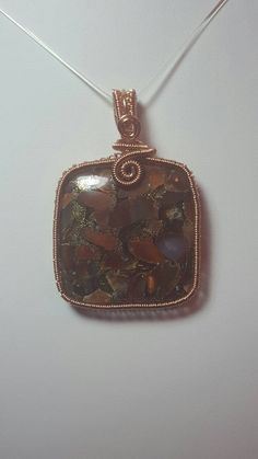 Check out this item in my Etsy shop https://www.etsy.com/uk/listing/467862372/wirework-carnelian-composite-pendant