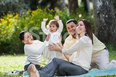 Cute little girl with family at park royalty-free stock photo