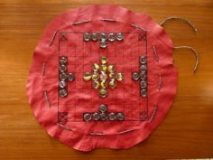 Leather hnefatafl board that doubles as a pouch to hold the pieces. could be made with fabric. should have rule print out.