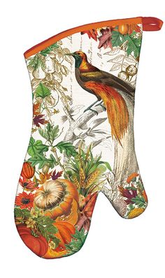 Every kitchen can use our new padded oven mitts. The front carries a captivating autumn design with pumpkins and fall leaves, the back is a coordinating orange, and the inside is quilted. Each oven mitt has extra length for added protection and is made of 100% cotton. Sold individually.