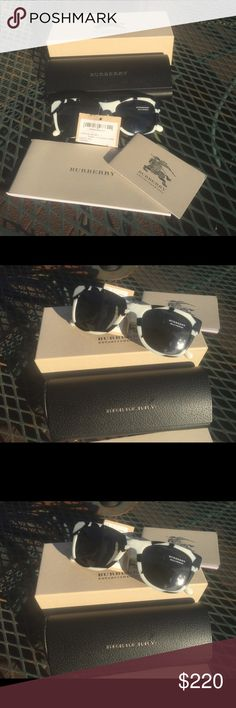 Burberry Sunglasses Authentic Burberry Zebra Style Black Lacquered Sunglasses  - 100%uv protection NWT; Comes with the following accessories: Sunglasses case; cleaning cloth; booklets and box. This beautiful sunglass would make an exceptionally great gift, as it is already to be gifted! Burberry Accessories Sunglasses