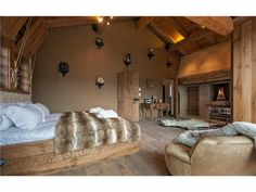 huge, beautiful, cozy bedroom with a fireplace, soft lights, a bear skin rug ... mmm, mmm