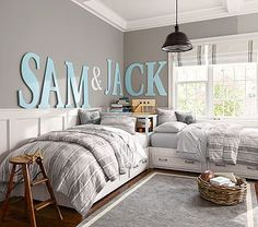 I am really liking these corner bed ideas and absolutely LOVE the names on the wall!