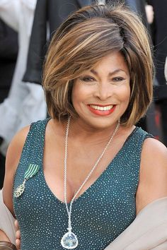 Tina Turner 73 wearing the medal she had just been awarded by the French govt. STYLE has nothing to do with age or money. Biddy Craft