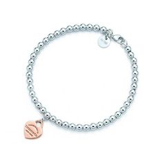 Return to Tiffany® bead bracelet in silver and RUBEDO® metal, medium. | Tiffany & Co.