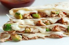 Enjoy these skinnied up traditional quesadillas with low-fat cheese, whole wheat tortillas, avocado, chicken, and barbeque sauce for a nice zing of flavor.