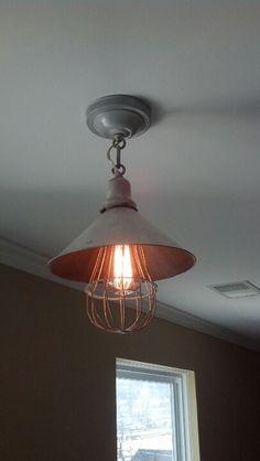 Repurposed industrial lighting components.