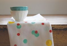 Paint a Quick Confetti Dishtowel. LOVE this. I was just wondering how to do something like this the other day. And I have the round sponges already! // danyelle @ make & takes