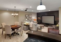Basement Flooring Combination Ideas. Basement Flooring: Most of the Lower Level has ceramic tiles in a wood look with in-floor heating. The tile is called Florim/Forest/Liana 6x36 Item 5615 from Rubble Tile in Minneapolis. The TV area has carpet for softer comfort. #BasementFlooring