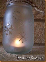 Frosting spray paint + mason jars + snowflake stickers