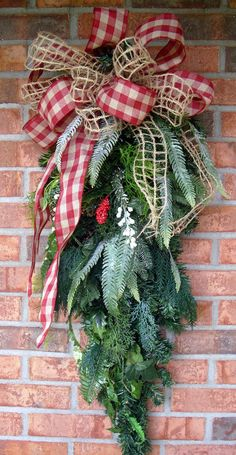 How to make a christmas swag swag outdoor christmas and wreaths christmas teardrop swag made with red checked and burlap window pane ribbon solutioingenieria Gallery
