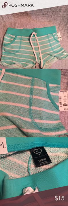 Aeropostale shorty shorts teal stripe size xxs New with tag Aeropostale live, laugh,love stretch shorty shorts. Cuffed bottom. Wide band, draw string. Aqua with white stripe. Size xxs. Aeropostale Shorts