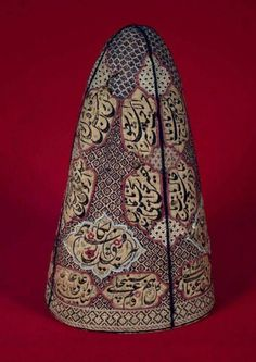 Mystic's felt hat embroidered in coloured silks with Persian and Arabic invocations, including the popular Shi'a invocation 'Call upon 'Ali, revealer of wonders …' Iran, century century CE Tribal Costume, Persian Motifs, Persian Culture, Boho Pillows, Vintage Textiles, Embroidered Silk, Islamic Art, Couture, Handmade Crafts