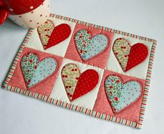This mug rug looks just as good as a mini-quilt on the wall - just add quick corner triangles to the back. Find out more about this mug rug at THE PATCHSMITH. Mug Rug Patterns, Patchwork Patterns, Quilt Patterns, Patchwork Heart, Block Patterns, Pdf Patterns, Diy Craft Projects, Sewing Projects, Small Quilts
