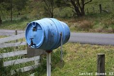 Another barrel letter box with a tap as door handle - Masterton-Castlepoint road