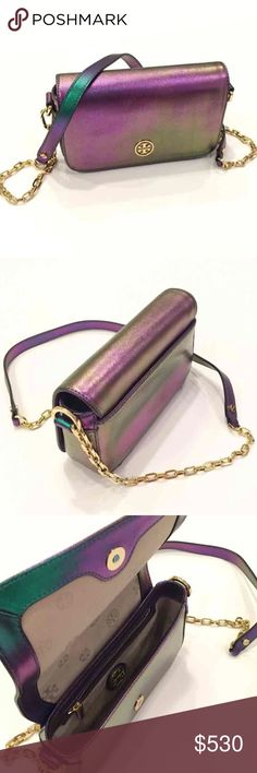 Tory Burch Hologram Robinson Cross body Bag Tory Burch   Rare Multi-Color Robinson Hologram Mini Crossbody/Shoulder Bag  Has a shimmering iridescent finish, with alternating shades of purples and greens depending on the angle/light.     * Magnetic clasp closure * Gold chain link; leather strap with 22″ drop * Interior includes a side zip pocket and gold-tone logo plaque * Logo jacquard lining * Exterior back open pocket * 4.75″H x 8″L x 2″D. * Saffiano Leather * Style number: 41139610 * Dust…