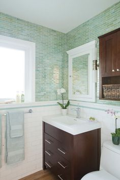 The tilework in this bathroom is amazing. Love the blue stick tile border with the white subway tile.