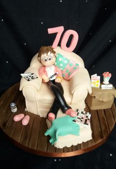 Ladies armchair cake created for a lady who loves her crosswords, carling larger and has given up smoking