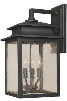 "Sutton Outdoor Wall Sconce 1-Light: 11.5""H x 7""W x 6""D. 3-Light: 16.5""H x 10.5""W x 9""D."